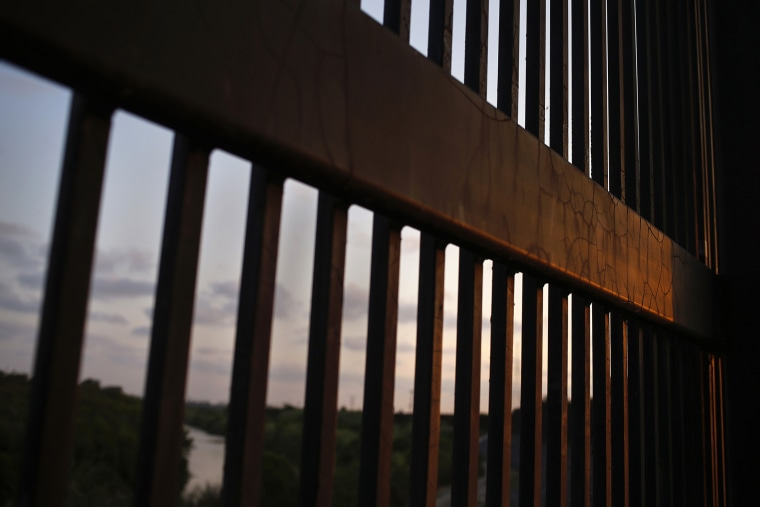 The border fence stands at the United States-Mexico border along the Rio Grande river in Brownsville, Texas. (Photo by Shannon Stapleton/Reuters)