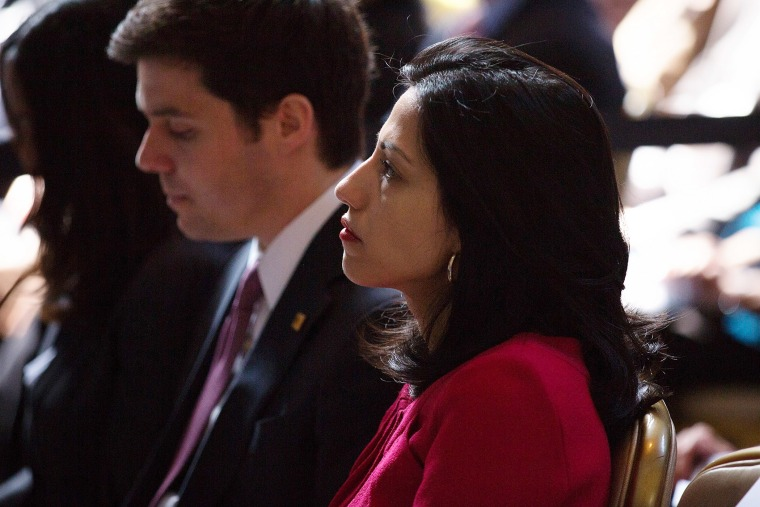 Clinton aide Huma Abedin watches as Secretary of State Hillary Clinton speaks at Columbia University April 29, 2015 in New York City. (Photo by Kevin Hagen/Getty)