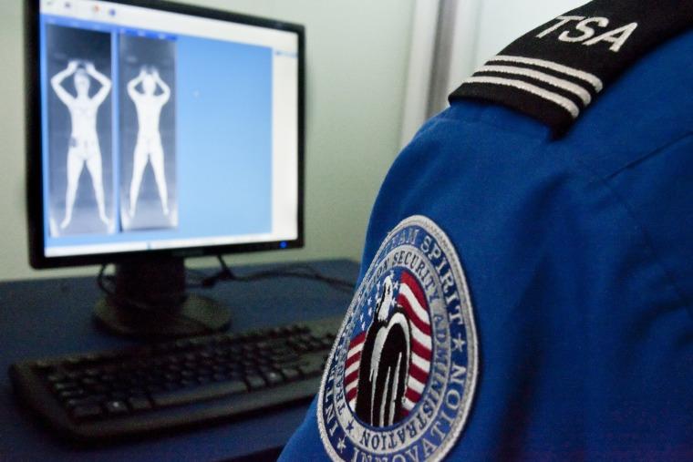 A TSA officer looks at a simulated image. (Photo by Nati Harnik/AP)