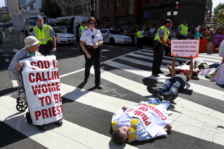 Protesters block a street outside Saint Matthew's Cathedral in Washington during Pope Francis' prayer meeting with U.S. bishops, Sept. 23, 2015. (Photo by Yuri Gripas/Reuters)