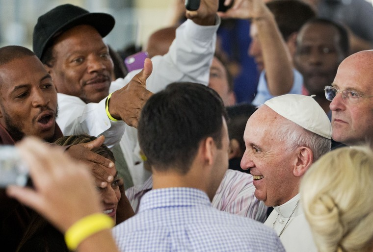 Supporters greet Pope Francis at the Catholic Charities office in Washington, Sept. 24, 2015. (Photo by Pool/Reuters)