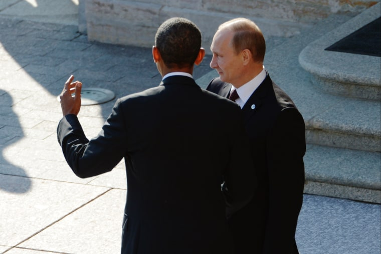 Russian President Vladimir Putin greets U.S. President Barack Obama at the G20 summit on September 5, 2013 in St. Petersburg, Russia. (Photo by Alexei Danichev/Host Photo Agency/Getty)