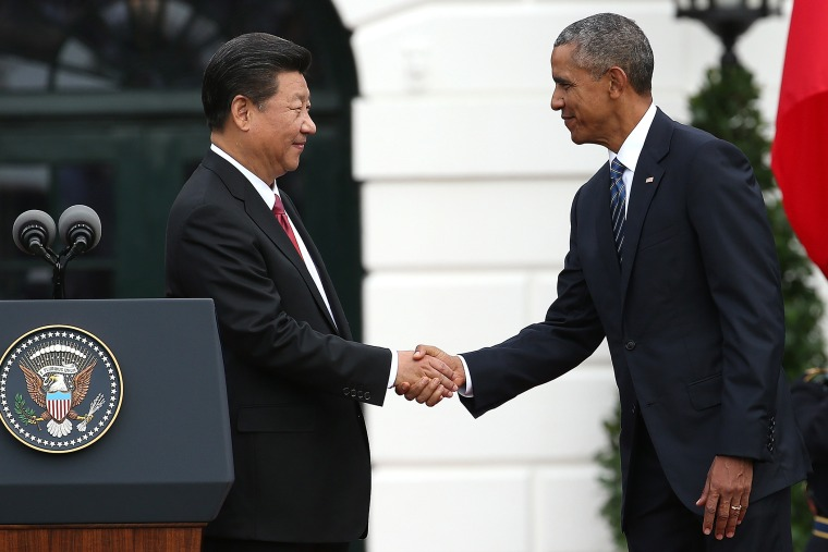 U.S. President Barack Obama shakes hands with Chinese President Xi Jinping on the south lawn of the White House grounds Sept. 25, 2015 in Washington, DC. (Photo by Win McNamee/Getty)