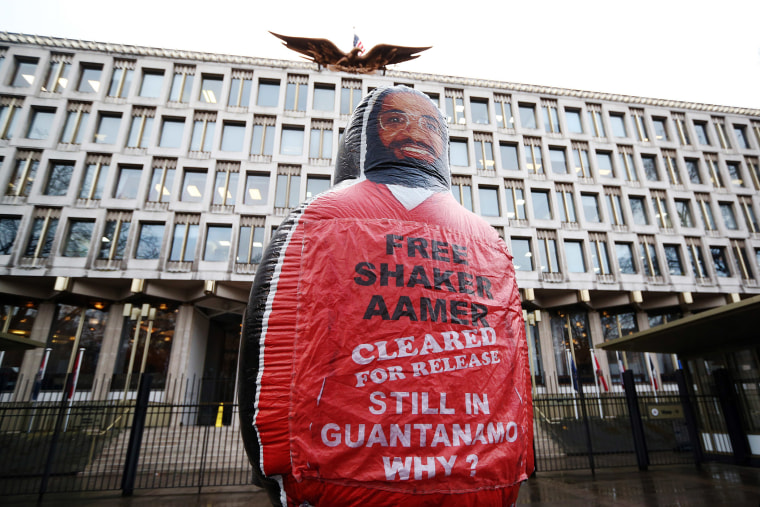 A giant inflatable figure of Shaker Aamer is pictured during a protest outside the U.S embassy on Feb. 13, 2015 in London, England. (Photo by Carl Court/Getty)