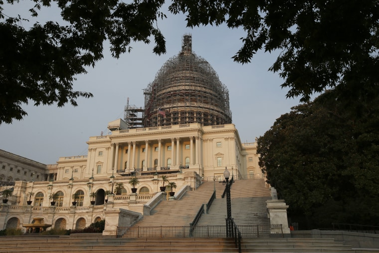 The west front of the U.S. Capitol is seen under repair Sept. 2, 2015 in Washington. (Photo by Alex Brandon/AP)
