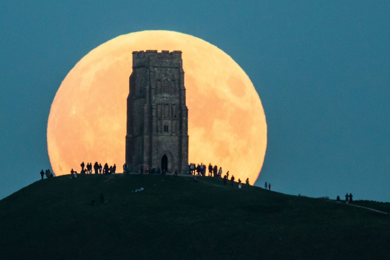 The supermoon rises behind Glastonbury Tor on Sept. 27, 2015 in Glastonbury, England.
