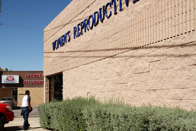 A man walks into a clinic that offers abortions in Santa Teresa, N.M., Friday, Oct. 3, 2014. Many similar clinics have been closed in recent years. (Photo by Juan Carlos Llorca/AP)