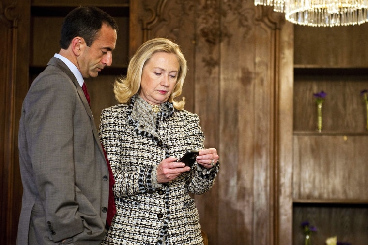 US Secretary of State Hillary Clinton looks at her phone during the 48th Munich Security Conference at the Bayerischer Hof hotel in Munich, Germany, Feb. 4, 2012. (Photo by Jim Watson/Pool/AP)