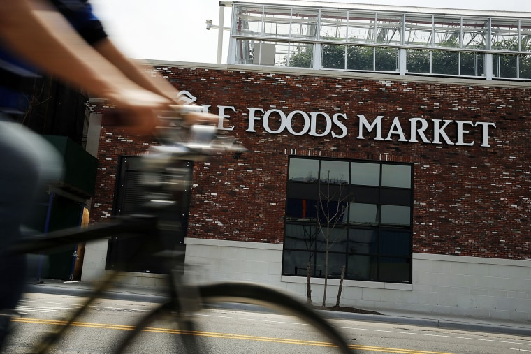 A person bikes past a Whole Foods Market in the Brooklyn borough on May 7, 2014 in New York City. (Photo by Spencer Platt/Getty)