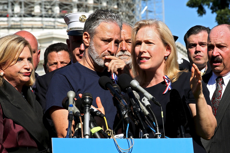 Comedian Jon Stewart listens to Senator Kirsten Gillibrand (D-NY) at an event to urge U.S. lawmakers to re-authorize the Zadroga Bill at the U.S. Capitol in Washington, Sept. 16, 2015. (Photo by Gary Cameron/Reuters)