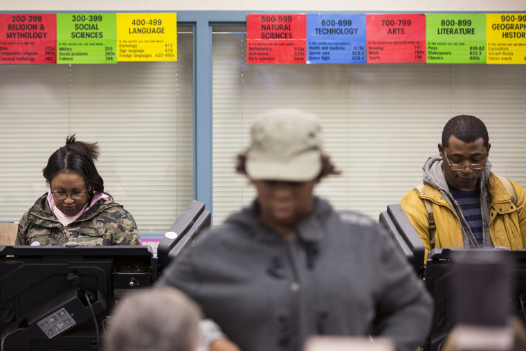 Voters cast their ballot in the U.S. midterm elections in Ferguson, Mo., Nov. 4, 2014. (Photo by Whitney Curtis/Reuters)
