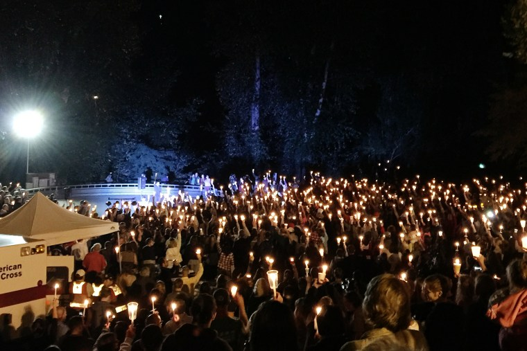 A candlelight vigil is held for the victims of the Umpqua Community College mass shooting in Stewart Park, Umpqua, Ore., Oct. 1, 2015. (Photo by Mike Brunker/NBC News)