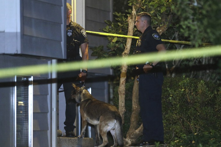 Law enforcement officers investigate a home in Roseburg, Ore., Oct. 1, 2015. A gunman opened fire inside a classroom at Umpqua Community College before dying in a shootout with police. (Photo by Rich Pedroncelli/AP)
