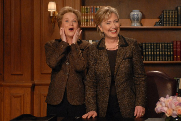 "Senator Hillary Clinton delivers an ""editorial response"" to SNL's parody of this week's Democratic debate with Amy Poehler who plays Clinton on the show, March 1, 2008. (Photo by Dana Edelson/NBC/NBCU Photo Bank/Getty)"