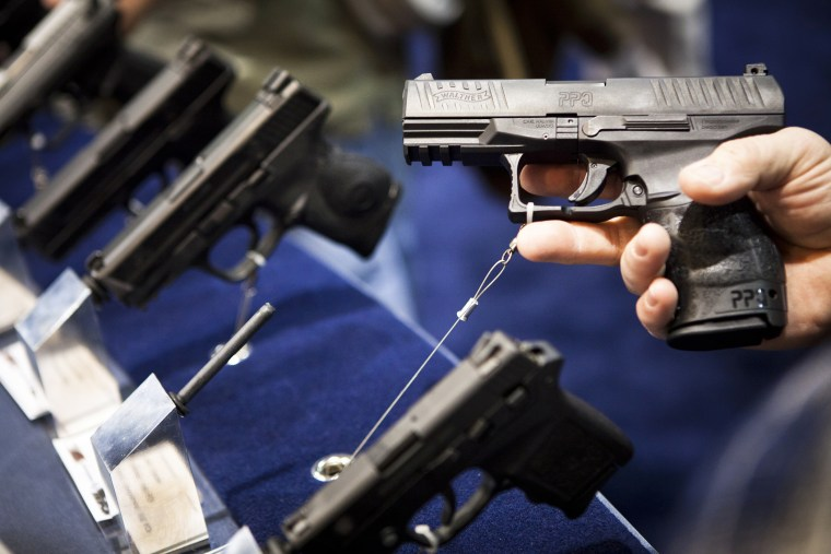 A handgun is displayed during a convention in Reno, Nevada on Jan. 29, 2011. (Photo by Max Whittaker/Reuters)