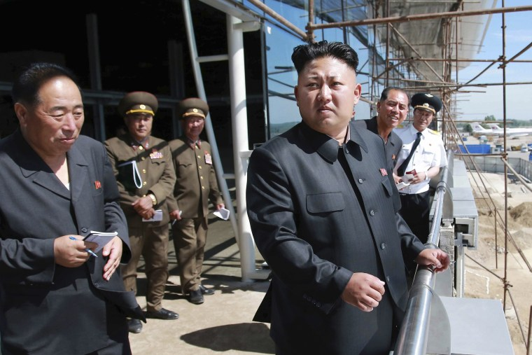 North Korean leader Kim Jong Un pays a visit to the construction site of a terminal at Pyongyang International Airport, July 11, 2014. (Photo by KCNA KCNA/Reuters)