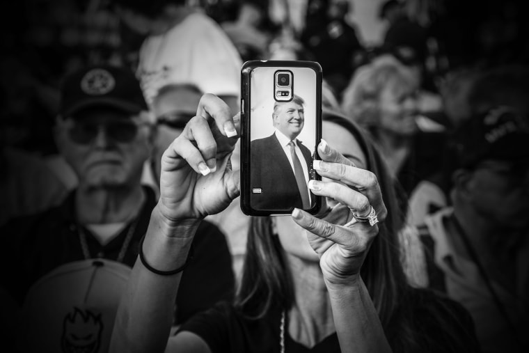 "A Donald Trump supporter uses her phone as the billionaire arrived at his ""Make America's Military Great Again"" rally, held aboard the retired USS Iowa battleship, in Los Angeles, Calif., Sept. 15, 2015. (Photo by Mark Peterson/Redux for MSNBC)"