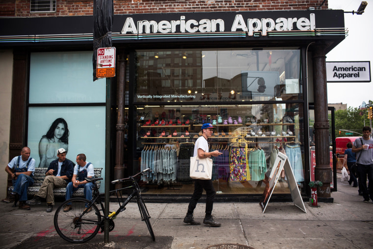 People walk past an American Apparel store on June 19, 2014 in New York, N.Y. (Photo by Andrew Burton/Getty)