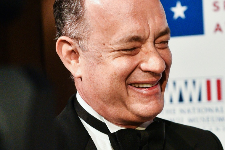 Tom Hanks smiles on the red carpet held at Cipriani on Wall Street, N.Y., for the WWII Museum, where Tom Brokaw and Tom Hanks received the Spirit Award, Feb. 24, 2015. (Photo by Sean Zanni/Patrick McMullan)