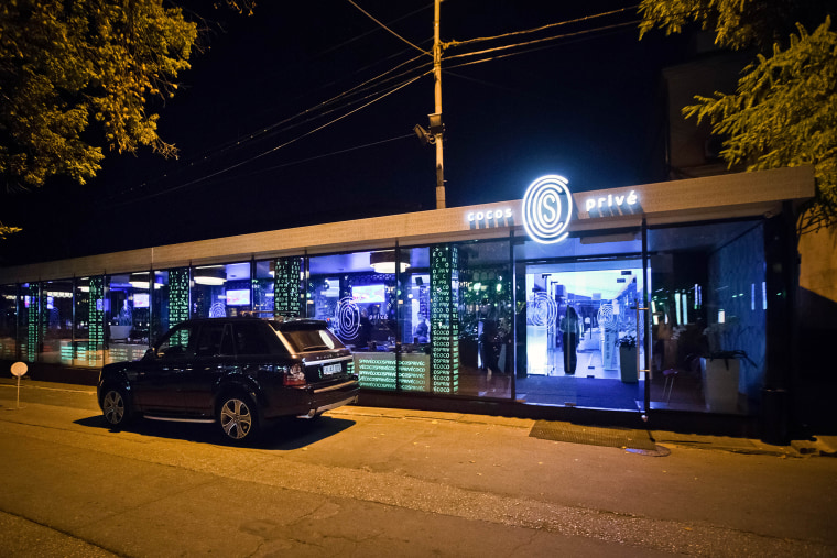 In this Oct. 5, 2015 photo, an imported luxury SUV is parked outside the Cocos Prive club in Chisinau, Moldova. (Photo by AP)