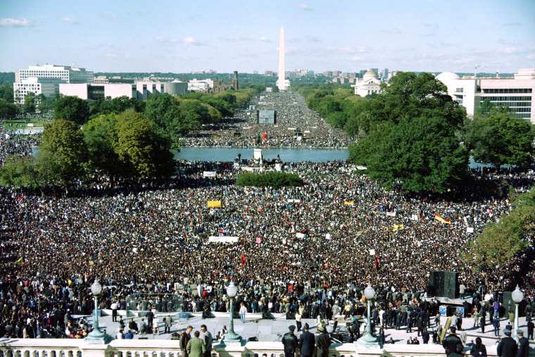"This photograph taken from the U.S. Capitol Building shows thousands of people gathered on the Mall during the ""Million Man March"" in Washington D.C., on Oct. 16, 1995. (Photo by Richard Ellis/AFP/Getty)"