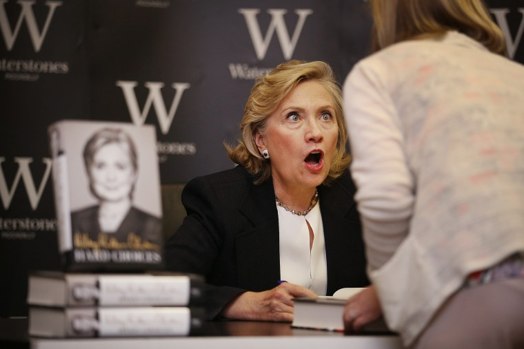 Former US Secretary of State Hillary Clinton reacts to a customer as she signs copies of her book at Waterstones bookshop on July 3, 2014 in London, England. (Photo by Peter Macdiarmid/Getty)