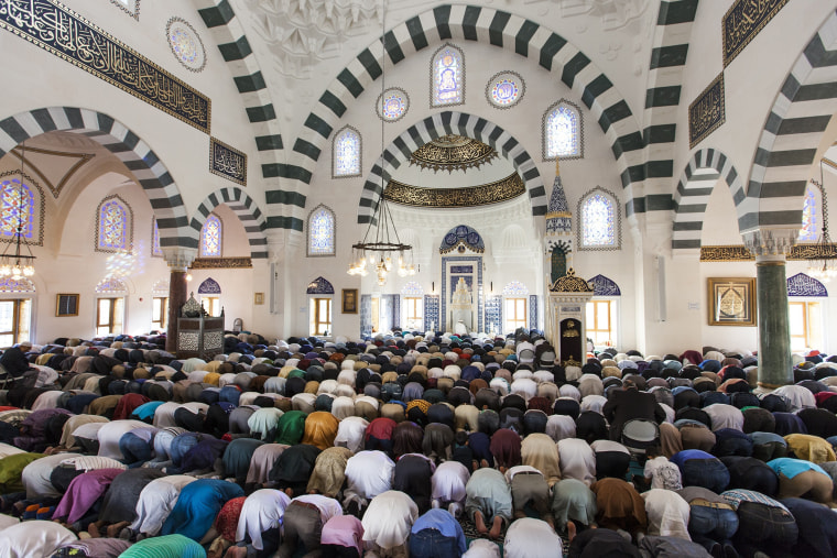 Thousands of Muslims gather at the Turkish American Cultural Center Mosque to observe Eid al-Fitr during the holy month of Ramadan in Lanham, Md., July 17, 2015. (Photo by Samuel Corum/Anadolu Agency/Getty)