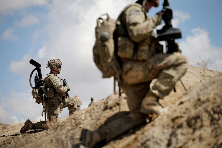 Sgt. Nathan Harrell with the U.S. Army's 2nd Battalion 87th Infantry Regiment, 3rd Brigade Combat Team, 10th Mountain Division, patrols on the edge of a village near Pul-e Alam, Afghanistan on March 29, 2014. (Photo by Scott Olson/Getty)