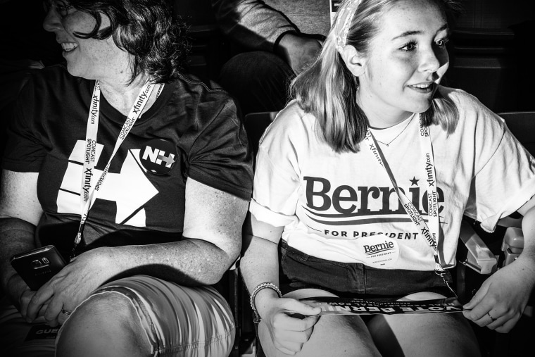 Supporters of rival democratic presidential candidates discuss their excitement before the start of the New Hampshire Democratic Convention in Manchester, N.H., Sept. 19, 2015. (Photo by Mark Peterson for MSNBC)