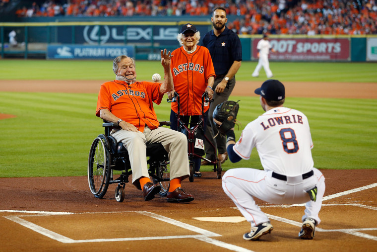 Former President George H.W. Bush throws out the ceremonial first pitch to Jed Lowrie #8 of the Houston Astros prior to game three of the American League Division Series, Oct. 11, 2015 in Houston, Texas. (Photo by Bob Levey/Getty)