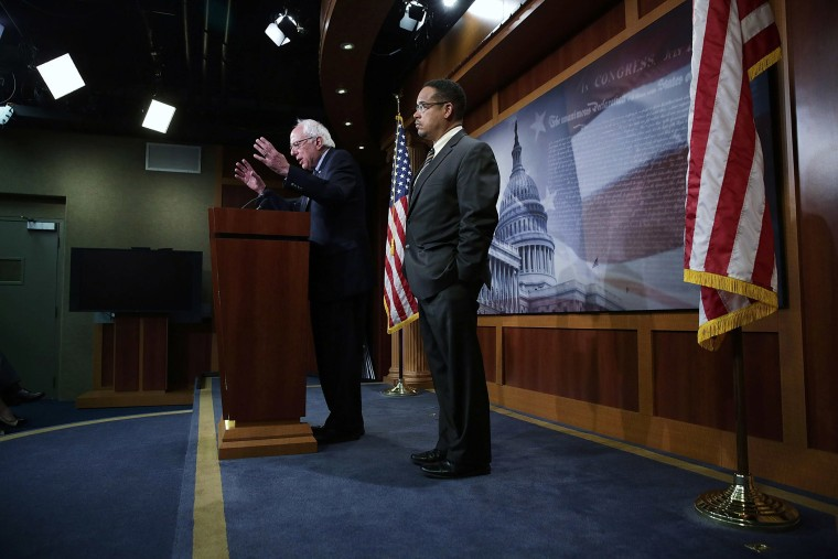 U.S. Sen. Bernie Sanders and Rep. Keith Ellison speak during a news conference about private prisons, Sep. 17, 2015 on Capitol Hill. The legislators announced that they will introduce bills to ban private prisons. (Photo by Alex Wong/Getty)