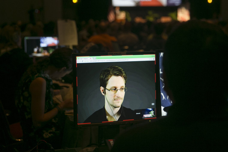 A video technician monitors a computer screen as Edward Snowden appears on a live video feed broadcast from Moscow at an event sponsored by the ACLU Hawaii in Honolulu on Feb. 14, 2015. (Photo by Marco Garcia/AP)