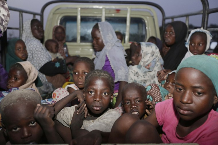 In this Saturday May 2, 2015 file photo, women and children rescued by Nigerian soldiers from Boko Haram at Sambisa forest arrive at a camp for the displaced people in Yola, Nigeria. (Photo by Sunday Alamba/AP)