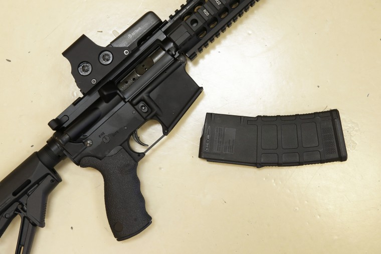 In this Oct. 3, 2013, file photo, a custom-made semi-automatic hunting rifle with a high-capacity detachable magazine is displayed at TDS Guns in Rocklin, Calif. (Photo by Rich Pedroncelli/AP)