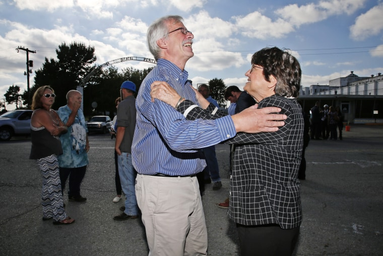 Death penalty opponent Sister Helen Prejean celebrates with a friend of death row inmate Richard Glossip after his scheduled execution was postponed outside the Oklahoma State Penitentiary in McAlester, Okla., Sept. 30, 2015. (Photo by Sue Ogrocki/AP)