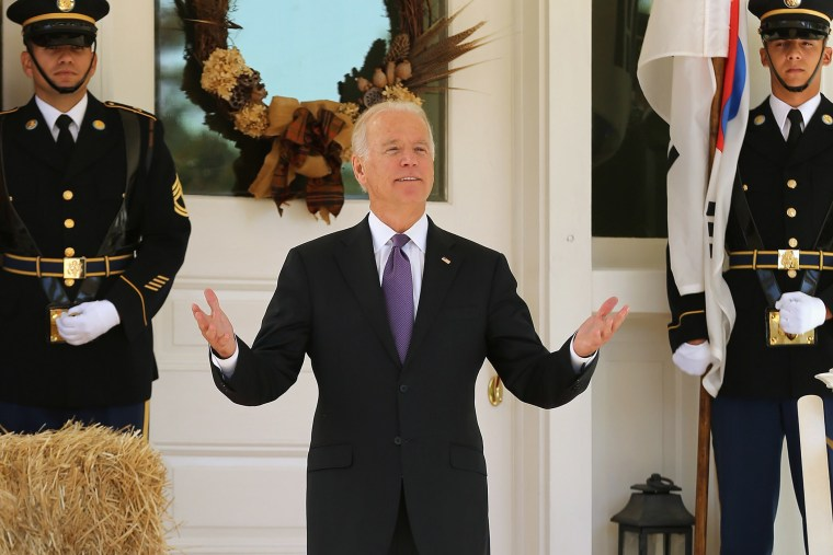 Vice President Joe Biden reacts to reporters' questions about him running for president while he waits for the arrival of President Park Geun-hye of South Korea at the Naval Observatory, Oct. 15, 2015 in Washington, DC. (Photo by Chip Somodevilla/Getty)