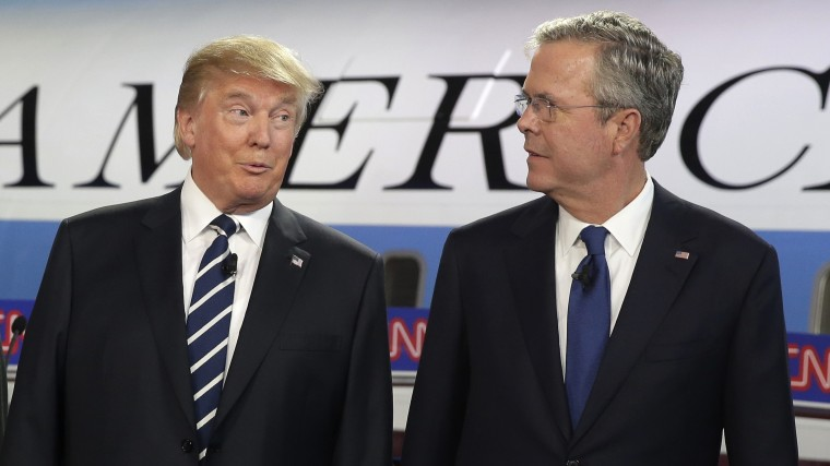 Republican presidential candidates Donald Trump and former Florida Gov. Jeb Bush talk together before the start of the CNN Republican presidential debate, Sep. 16, 2015, in Simi Valley, Calif. (Photo by Chris Carlson/AP)