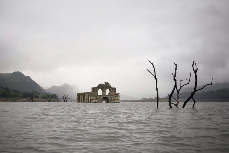The remains of a mid-16th century church known as the Temple of Santiago, visible from the surface of the Grijalva River due to the lack of rain near the town of Nueva Quechula, in Chiapas state, Mexico, Oct. 16, 2015. (Photo by David von Blohn/AP)