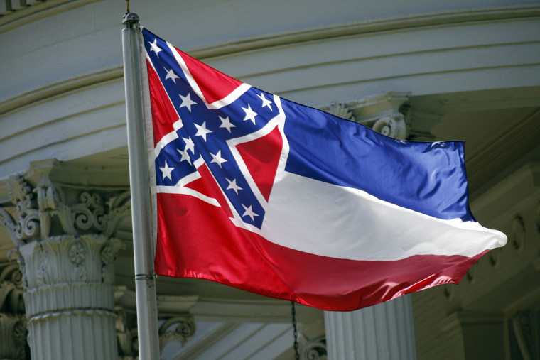 In this photo taken June 23, 2015, the Mississippi state flag is flown in Jackson, Miss. (Photo by Rogelio V. Solis/AP)