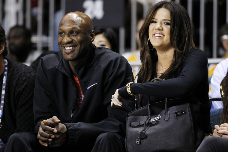 Los Angeles Lakers' Lamar Odom and his wife television personality Khloe Kardashian sit courtside as they attend the 2011 NBA All-Star basketball weekend in Los Angeles, Feb. 18, 2011. (Photo by Danny Moloshok/File/Reuters)