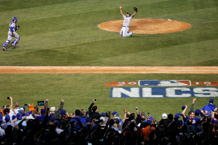 Jeurys Familia #27 and Travis d'Arnaud #7 of the New York Mets celebrate after defeating the Chicago Cubs in game four of the 2015 MLB National League Championship Series at Wrigley Field on Oct. 21, 2015 in Chicago, Ill. (Photo by Jon Durr/Getty)