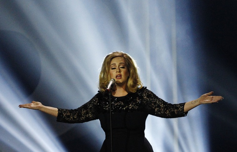 Adele performs during the Brit Awards 2012 at the O2 Arena in London, Feb. 21, 2012. (Photo by Joel Ryan/AP)