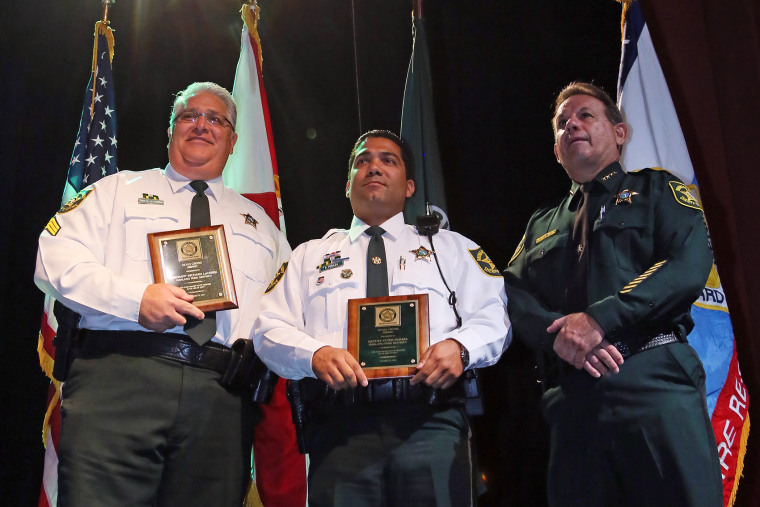 Sgt. Richard LaCerra, left, and Deputy Peter Peraza received Gold Cross Awards from Sheriff Scott Israel during the Broward Sheriff's Office Awards Ceremony, Oct. 22, 2013, in Fort Lauderdale, Fla. (Photo by Amy Beth Bennett/Sun Sentinel)