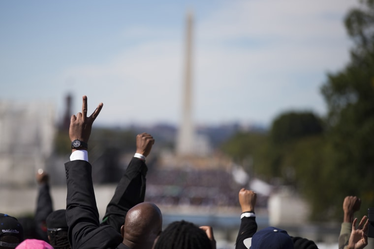 People put their hands in the air during a rally to mark the 20th anniversary of the Million Man March, on Capitol Hill, on Oct. 10, 2015, in Washington. (Photo by Evan Vucci/AP)