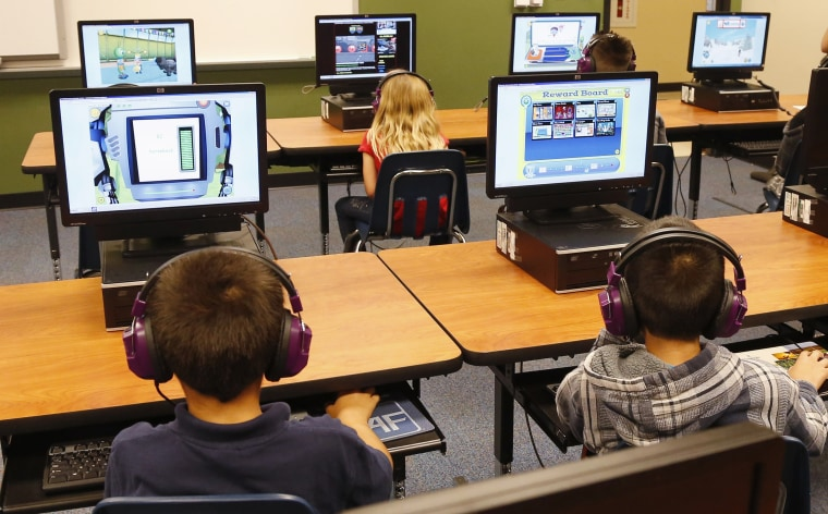 Students at Buchanan elementary school work in the computer lab in Oklahoma City, July 21, 2014. President Obama called Saturday for capping standardized testing at 2 percent of classroom time. (Photo by Sue Ogrocki/AP)