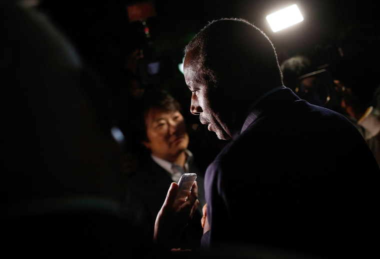 Republican presidential candidate Dr. Ben Carson answers questions from members of the press after delivering brief remarks to supporters at the King Street Retail Walk, Oct. 16, 2015 in Alexandria, Va. (Photo by Win McNamee/Getty)