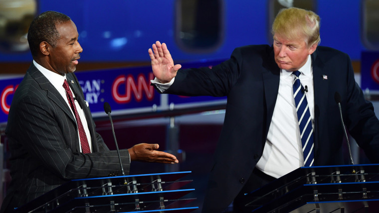Republican presidential hopefuls Ben Carson and Donald Trump high five during the second Republican Presidential Debate held at the Ronald Reagan Presidential Library in Simi Valley, Calif. on Sept. 16, 2015. (Photo by Frederic J. Brown/AFP/Getty)