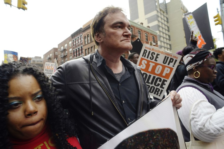 Director Quentin Tarantino participates in a rally to protest against police brutality, Oct. 24, 2015, in New York. Speakers at the protest said they want to bring justice for those who were killed by police. (Photo by Patrick Sison/AP)