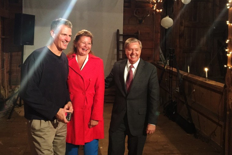 """Sen. Scott Brown and his wife, journalist Gail Huff, pose with Sen. Lindsey Graham after the presidential candidate spoke at one of Brown's """"No BS Backyard BBQs."""" (Photo by Kailani Koenig)"""