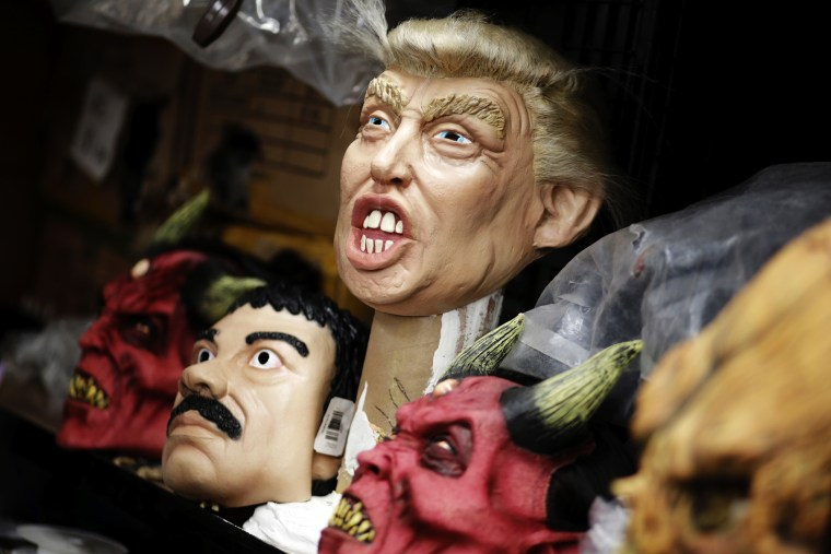 "Masks of Republican presidential candidate Donald Trump and Joaquin ""El Chapo"" Guzman are seen at Grupo Rev in the Mexican city of Cuernavaca near Mexico City, Oct. 14, 2015. (Photo by Henry Romero/Reuters)"